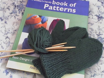 Green mittens and a hand book