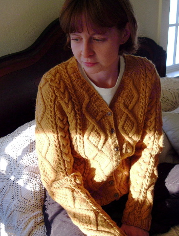 me in the sweater on the bed