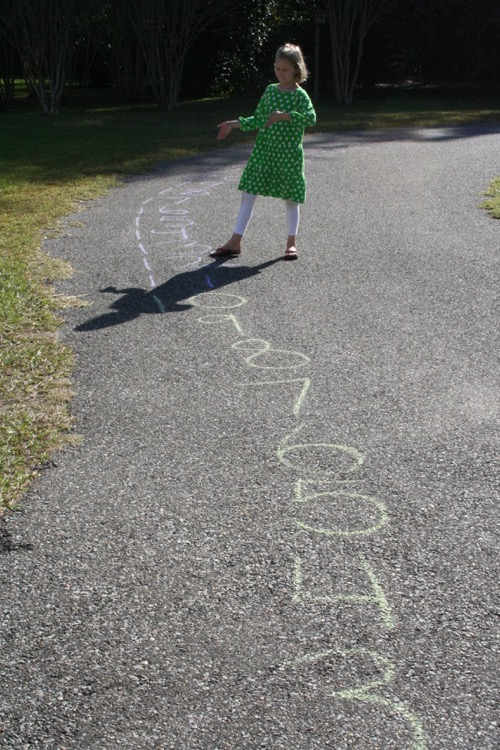 Demonstrating 3 x 4 = 12 on out MASSIVE number line that goes all around the driveway.