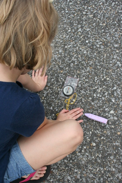 Finding North.  She drew a compass rose in the driveway.  There was also a map to buried treasure.